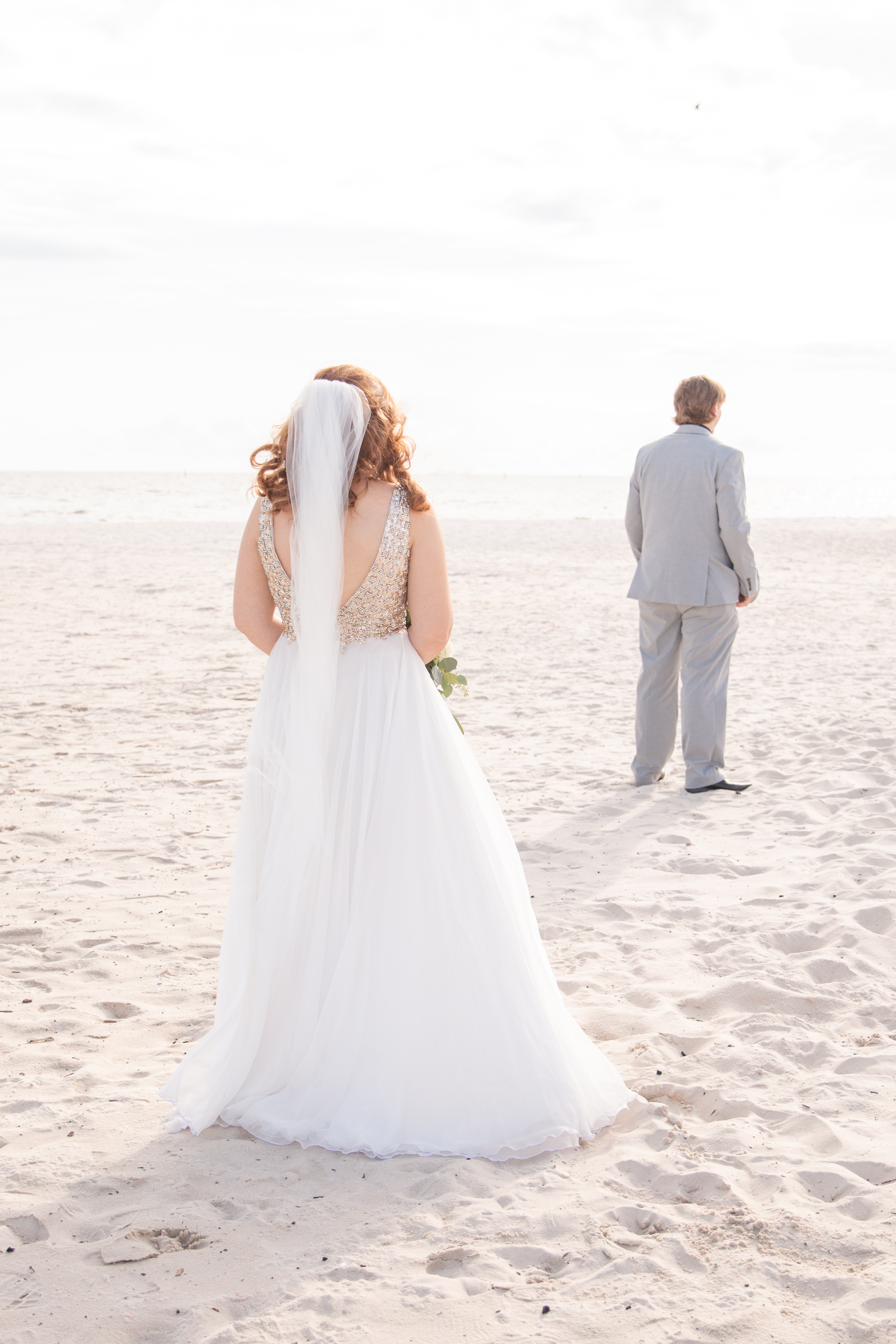 Gulfport Beach Wedding | Annie Elise Photography | first look | back to bride