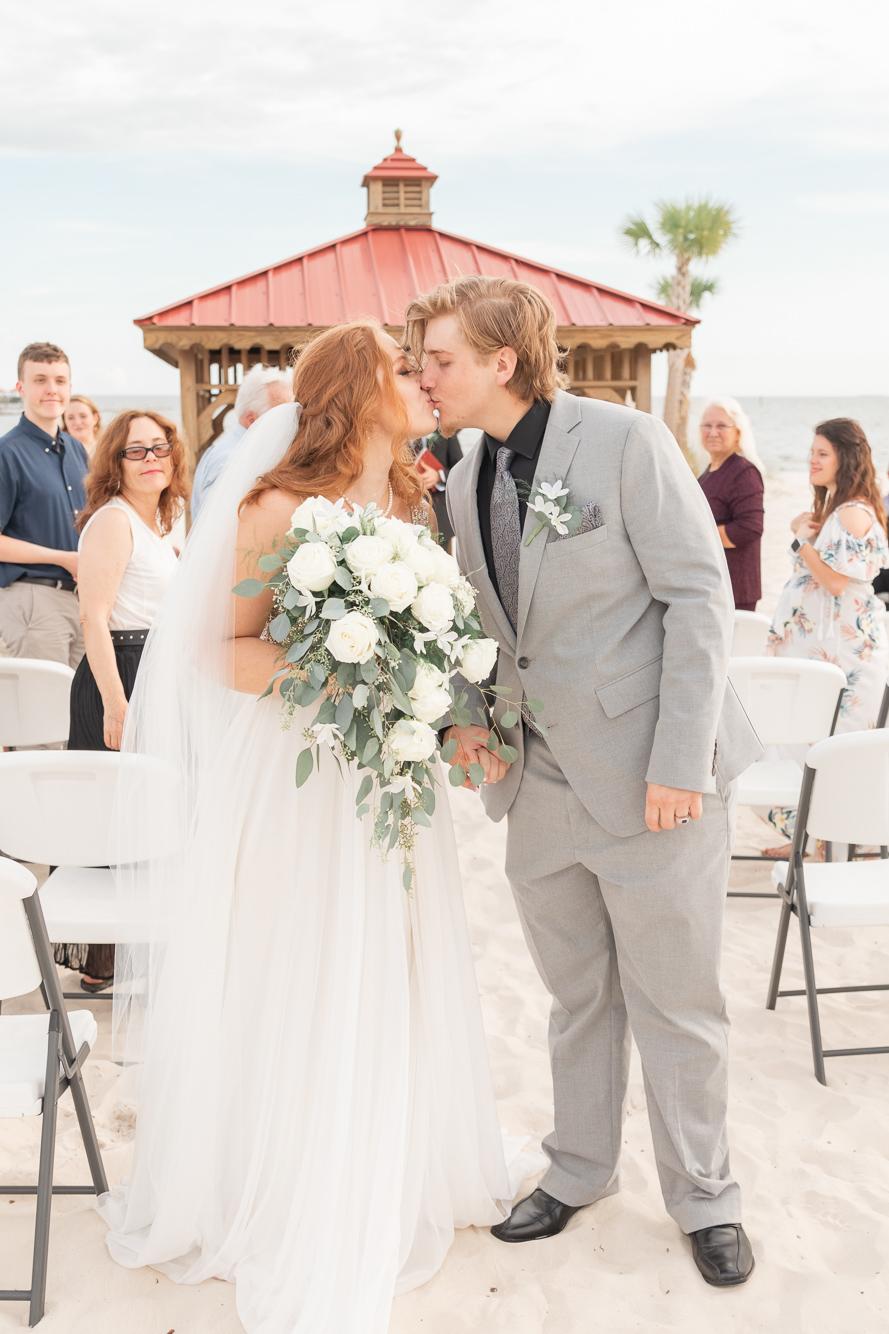Gulfport Beach Wedding | Annie Elise Photography | walking down aisle kiss