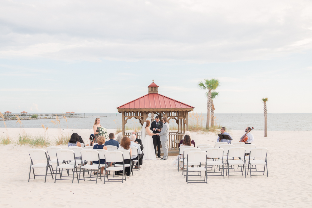 Gulfport Beach Wedding | Annie Elise Photography | Wide angle view of ceremony by gazebo
