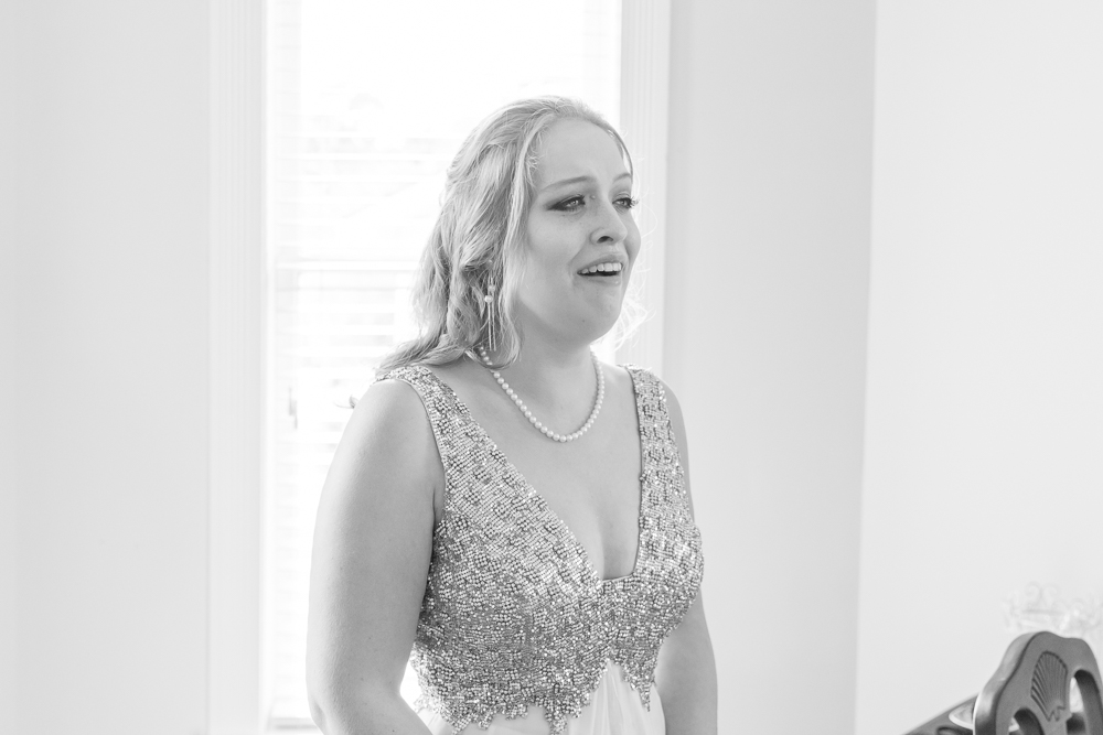 Black and white photo bride's first look at herself | Sequin Dress | Annie Elise Photography