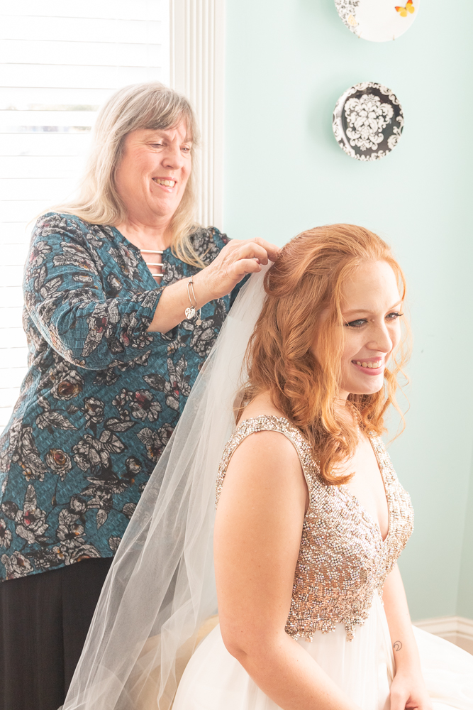 Gulfport Beach Wedding | Mother and Daughter putting in veil | Annie Elise Photography