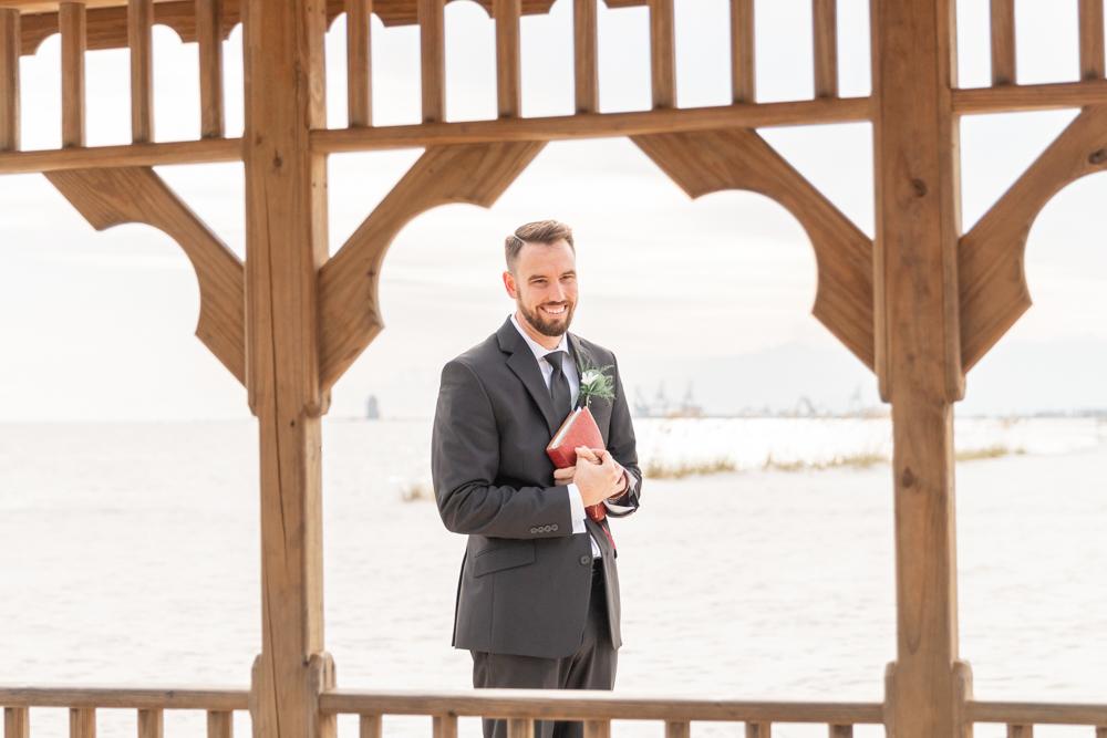 Gulfport Beach Wedding | Annie Elise Photography | celebrant holding bible before ceremony