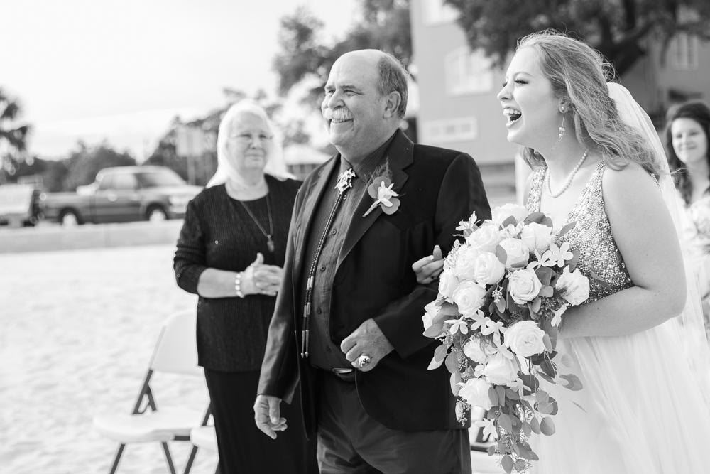 Gulfport Beach Wedding | Annie Elise Photography | black and white bride laughing and walking down aisle