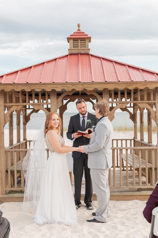 Gulfport Beach Wedding | Annie Elise Photography | ceremony bride looking at audience by gazebo