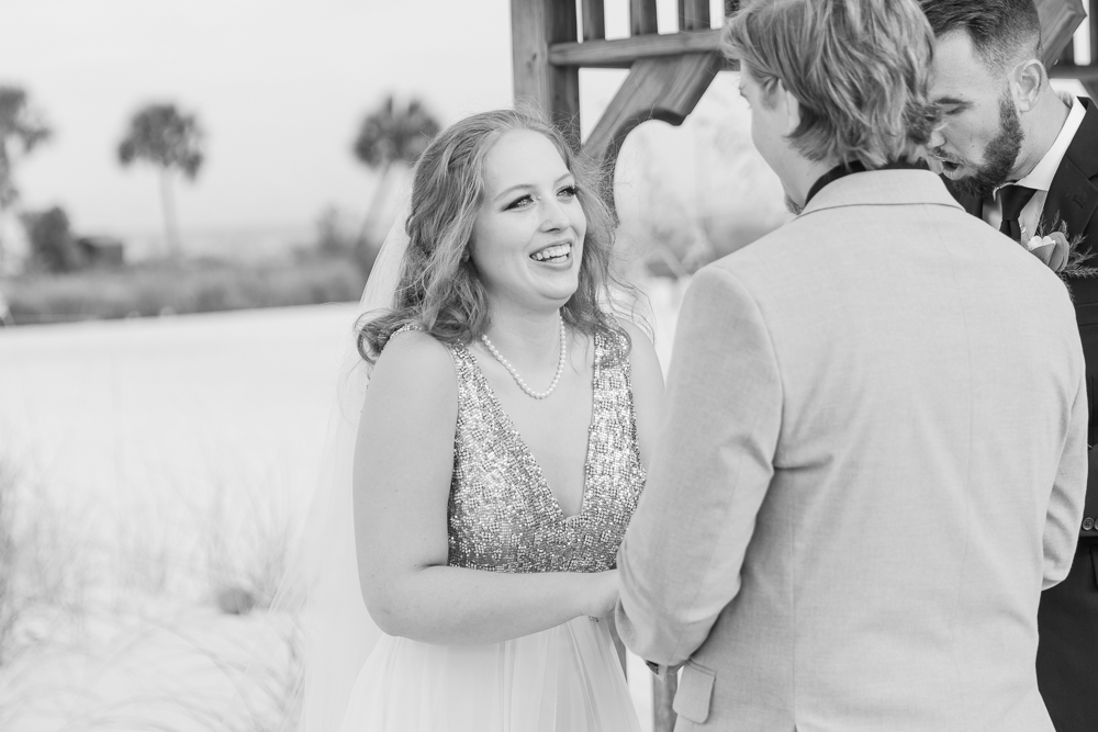 Gulfport Beach Wedding | Annie Elise Photography | black and white bride giggling at groom