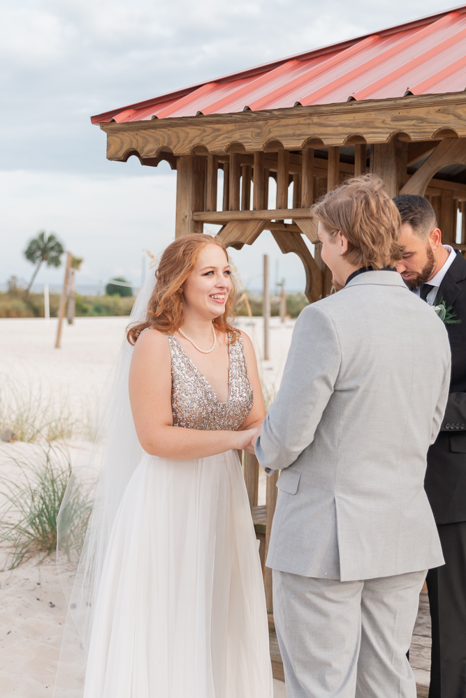 Gulfport Beach Wedding | Annie Elise Photography | bride looking at groom during ceremony