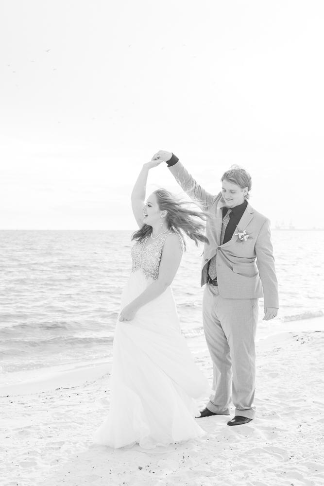Gulfport Beach Wedding | Annie Elise Photography | bride and groom twirl on beach