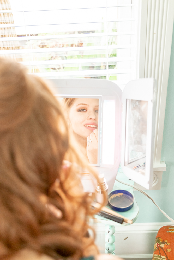 Bride putting on makeup by window light | Mirror Reflection | Annie Elise Photography