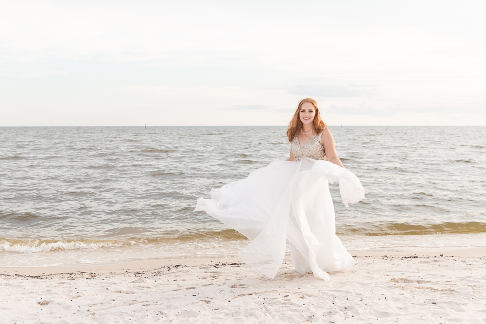 Gulfport Beach Wedding | Annie Elise Photography | bride twirling on beach