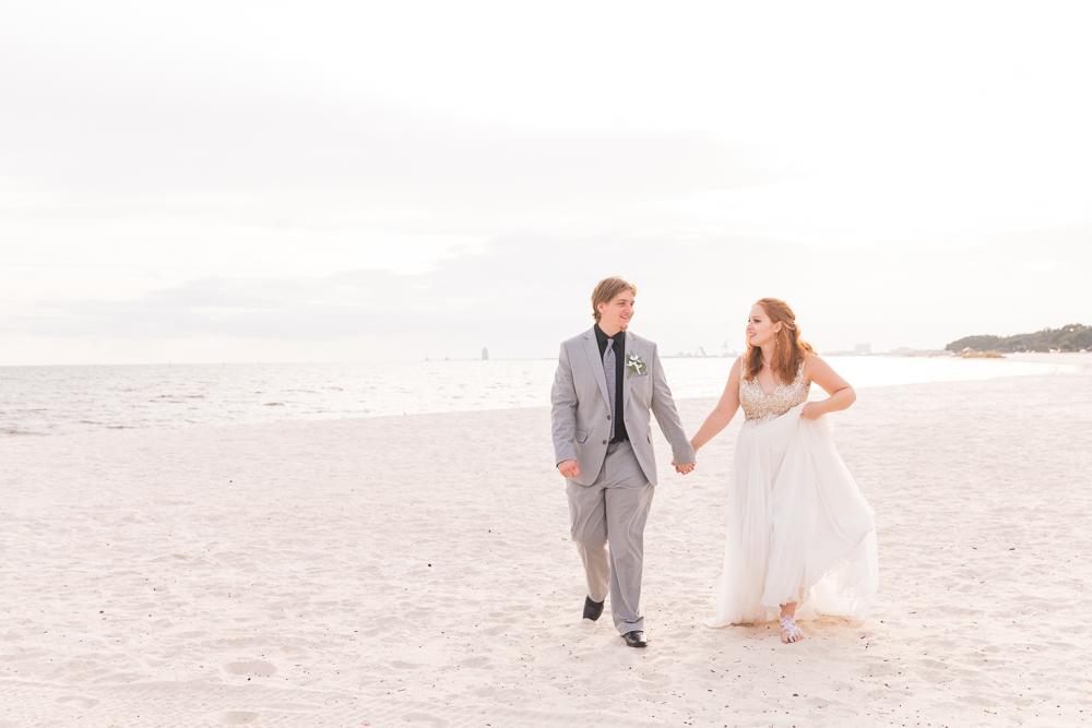 Gulfport Beach Wedding | Annie Elise Photography | bride and groom walking along beach