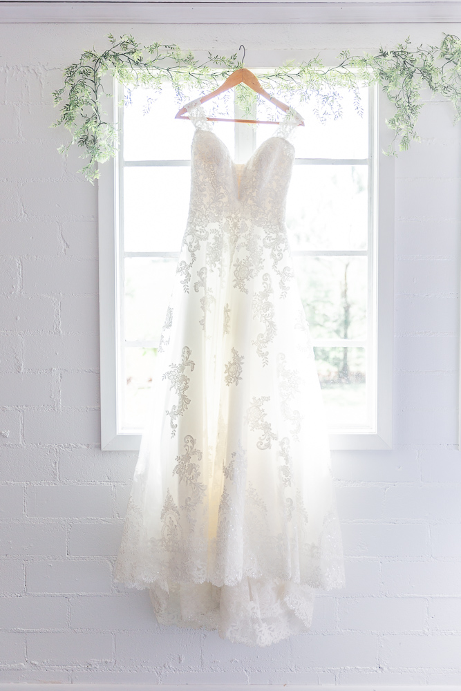 Annie Elise Photography | Bride detail  | I Do Bridal | Wood Hanger | White Window | Cinderella wedding dress | Lace detail
