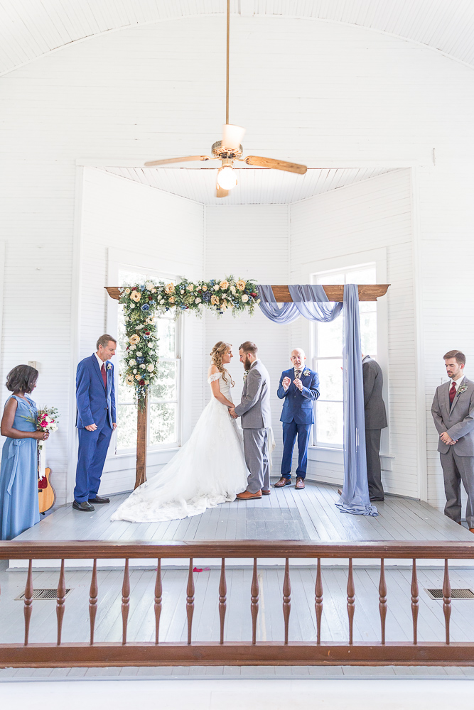 Annie Elise Photography | Ceremony | Clark's White Chapel Inside | Flower Arbor | Slate Blue Wedding | State Line, MS