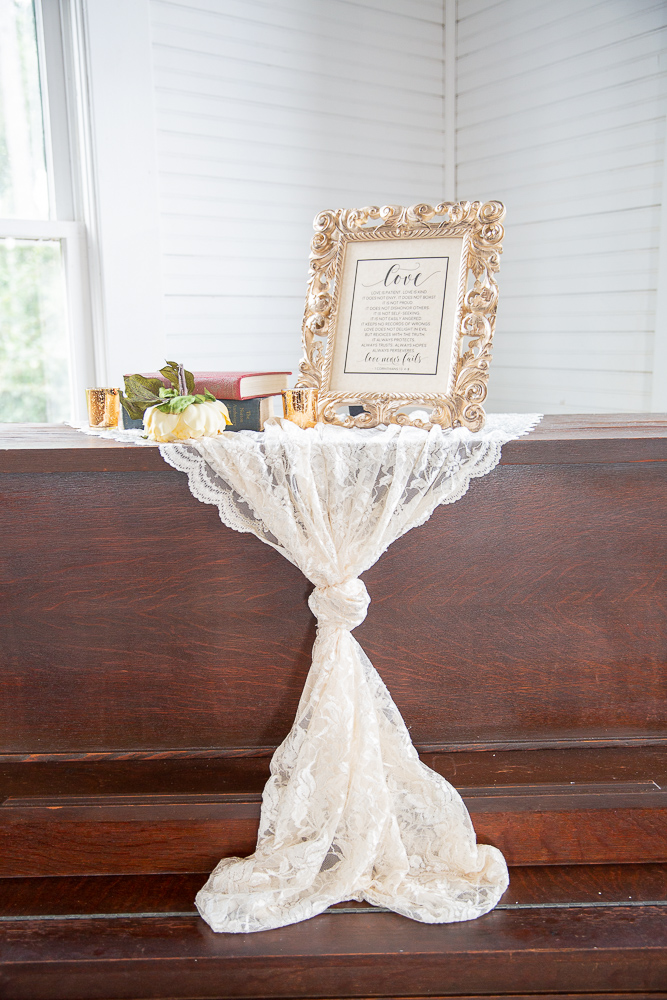 Annie Elise Photography | Ceremony decor | Love sign | White lace