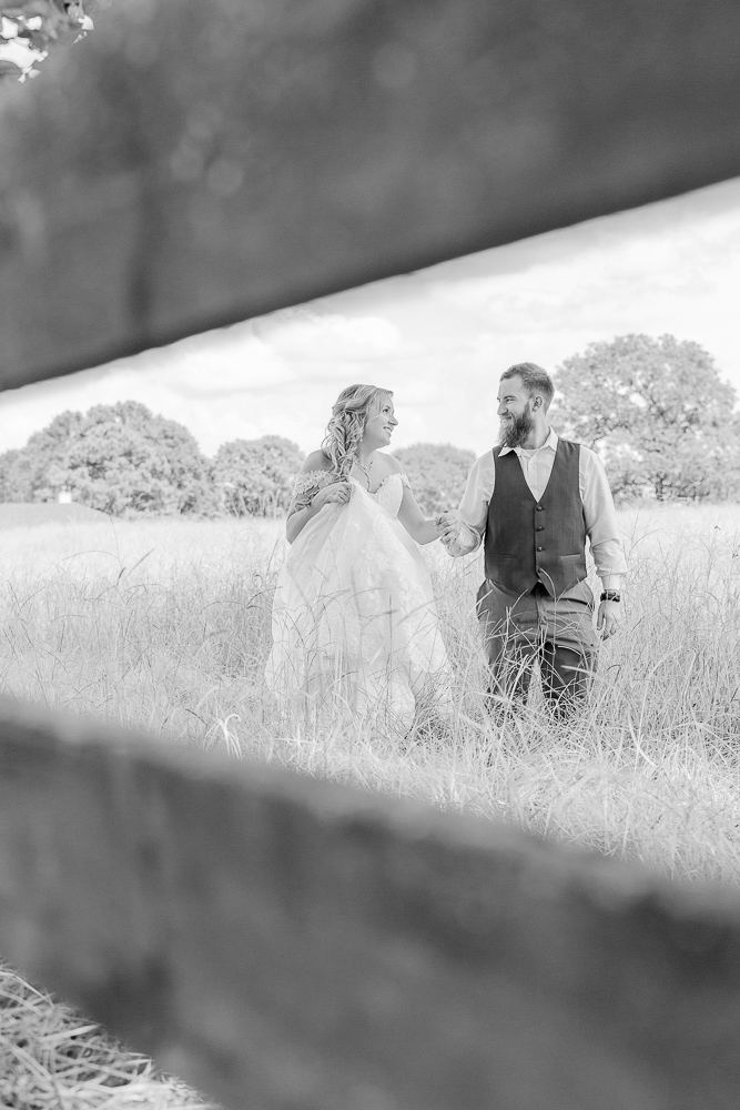 Mississippi Wedding Photographer | Grassy Field Bride and Groom Portraits | Wedding Dress | Bliss Bridal | I Do Bridal | black and white