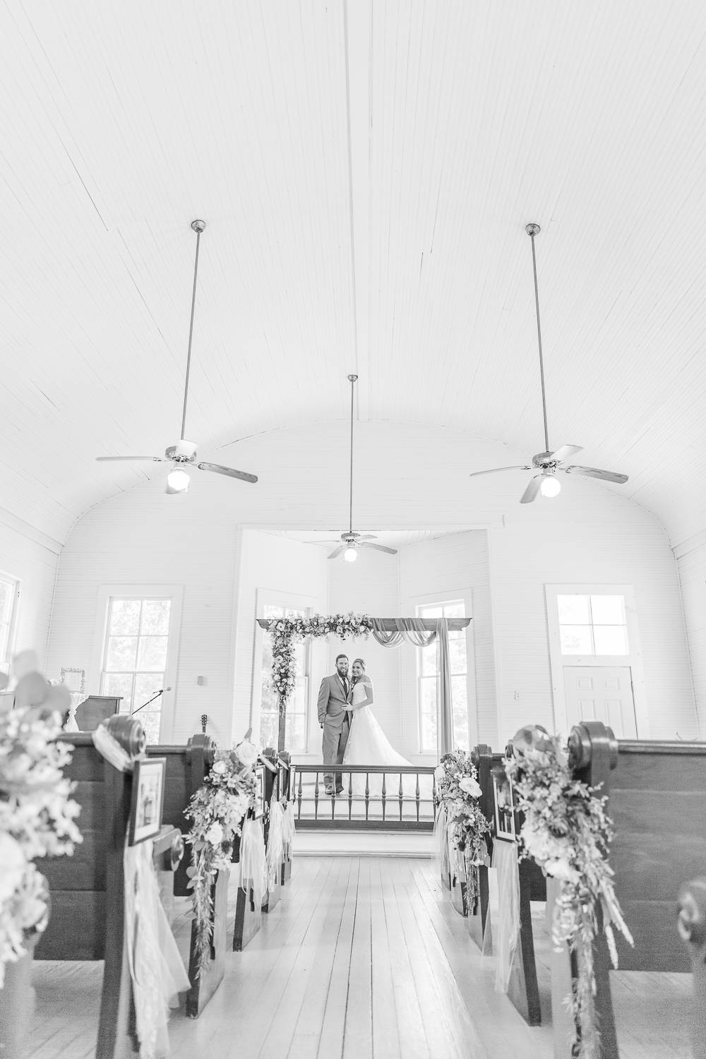 Annie Elise Photography | Ceremony | black and white bride and groom portraits | Inside white church | Slate Blue Wedding