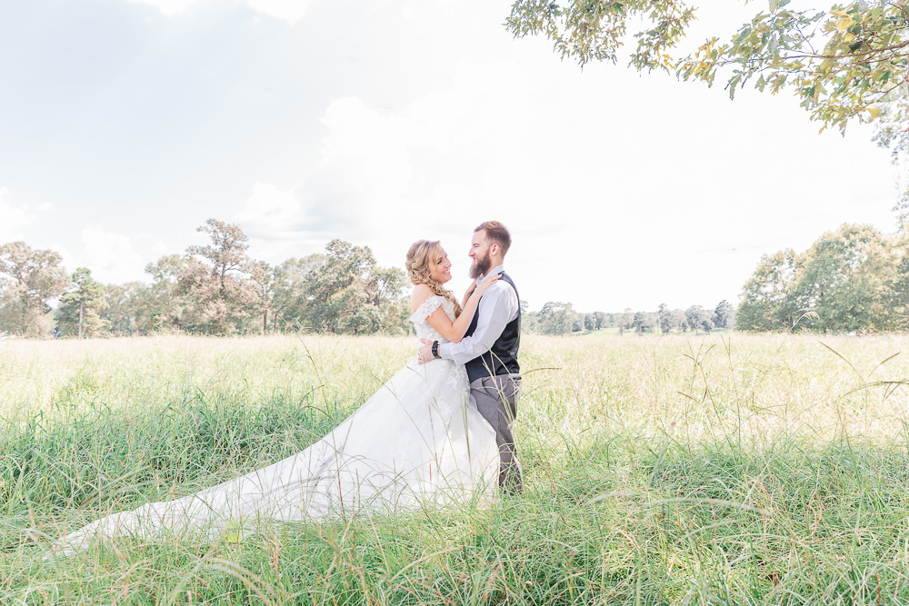 Mississippi Wedding Photographer | Grassy Field Bride and Groom Portraits | Wedding Dress | Bliss Bridal | I Do Bridal | blue sky | blonde braid | wedding hair