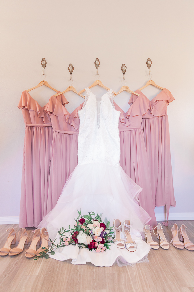 Annie Elise Photography | The Stables Venue | Vancleave, MS | Rustic Barn Wedding | Pink bridesmaid dresses | wedding dress | wedding detail shot