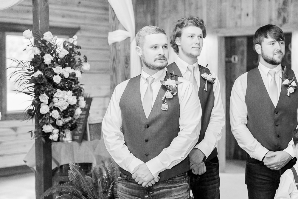 Annie Elise Photography | The Stables Venue | Vancleave, MS | Rustic Barn Wedding | Groom first look | Black and White