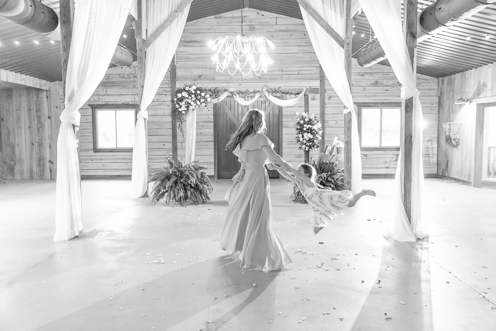Annie Elise Photography | The Stables Venue | Vancleave, MS | Bridesmaid swinging flower girl