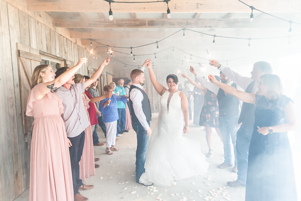 Annie Elise Photography | The Stables Venue | Vancleave, MS | Sparkler Exit | Bride twirling