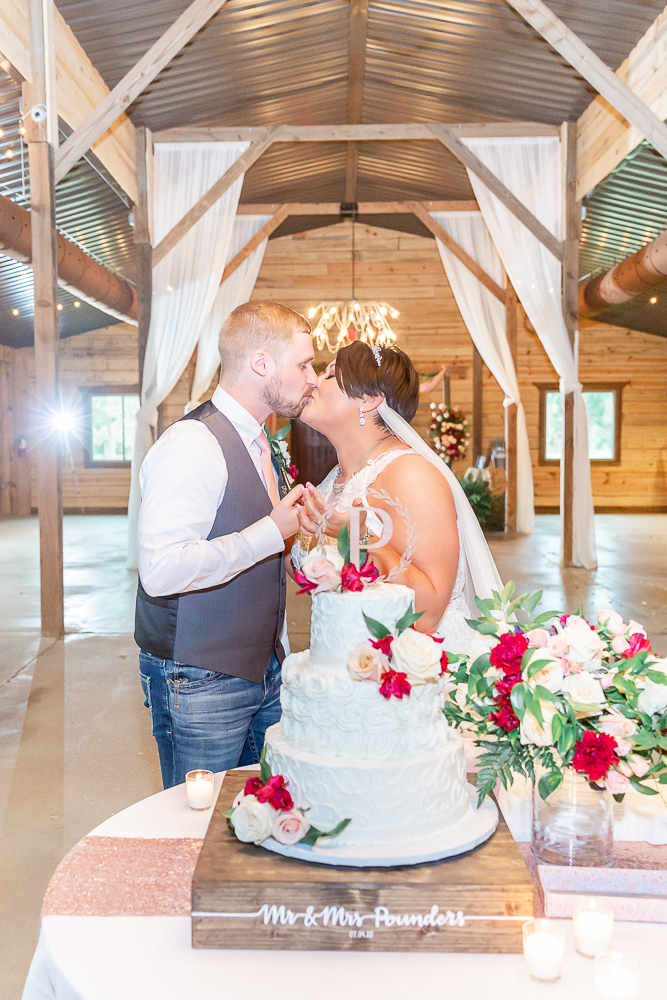 Annie Elise Photography | The Stables Venue | Vancleave, MS | Wedding Cake | Kissing | Dusty Rose Color