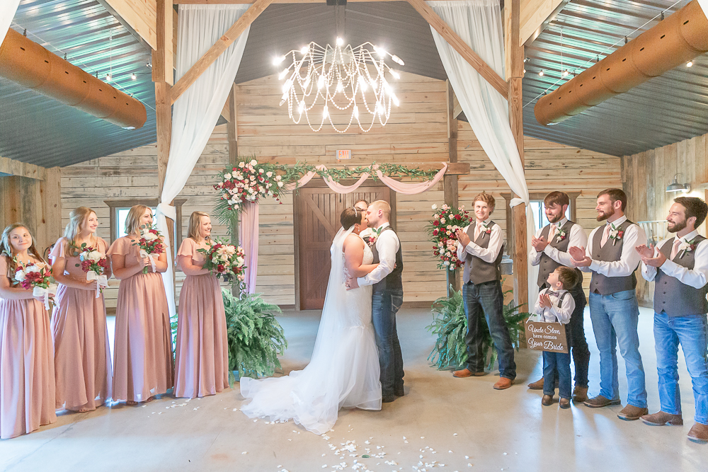 Annie Elise Photography | The Stables Venue | Vancleave, MS | Rustic Barn Wedding | First kiss