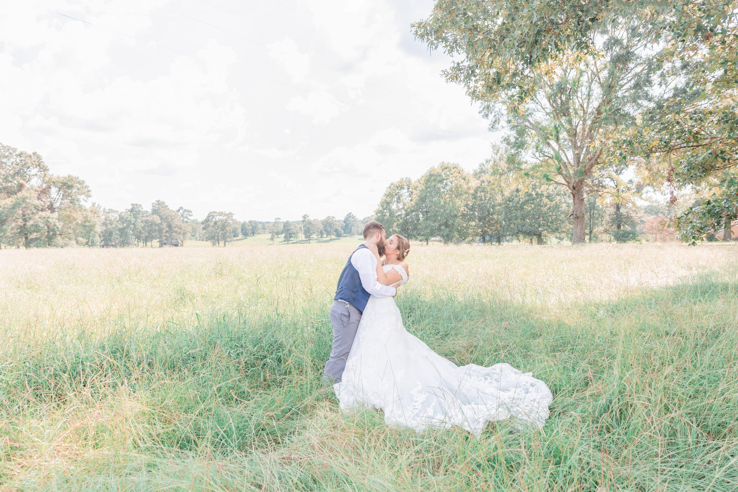 Mississippi Wedding Photographer | Grassy Field Bride and Groom Portraits | Wedding Dress | Bliss Bridal | I Do Bridal | Kissing | Dip