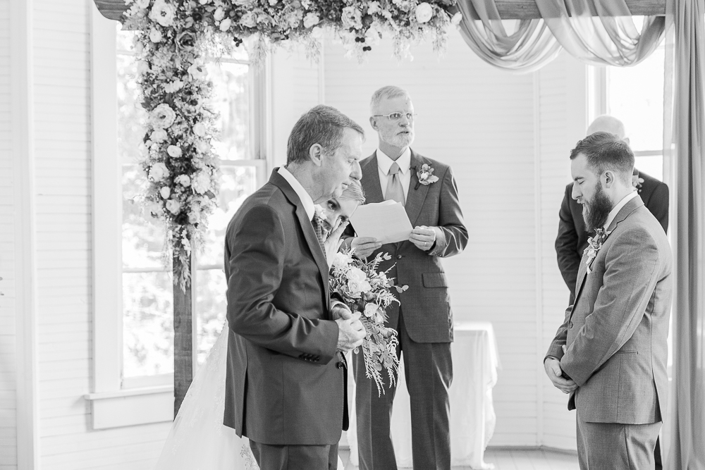 Annie Elise Photography | Ceremony | Clark's Chapel Inside | Flower Arbor | Slate Blue Wedding | Bride crying | black and white