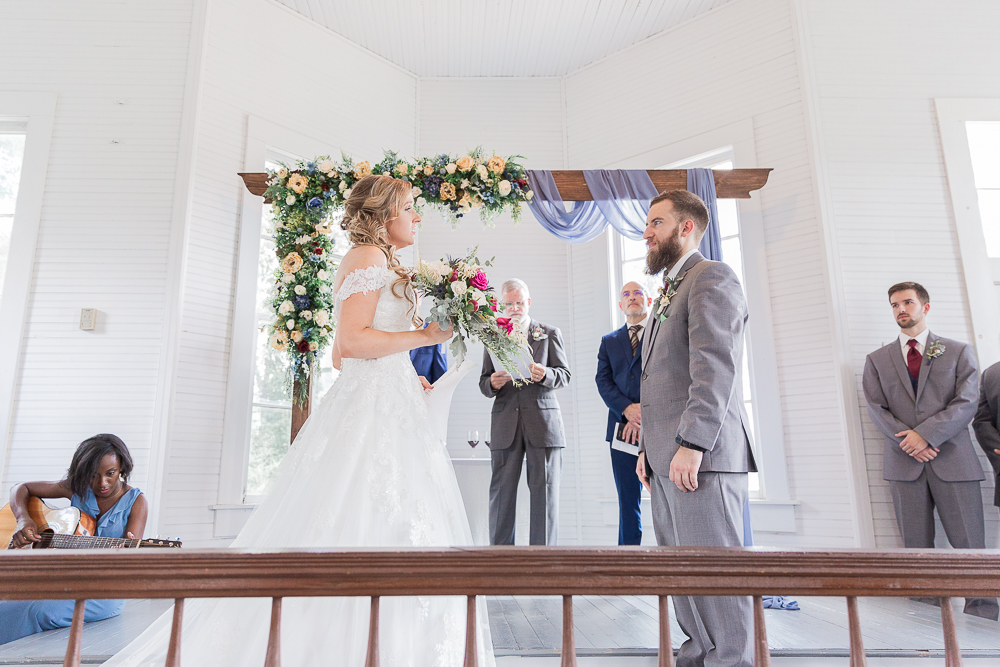 Annie Elise Photography | Ceremony | Clark's Chapel Inside | Flower Arbor | Slate Blue Wedding | Bride singing