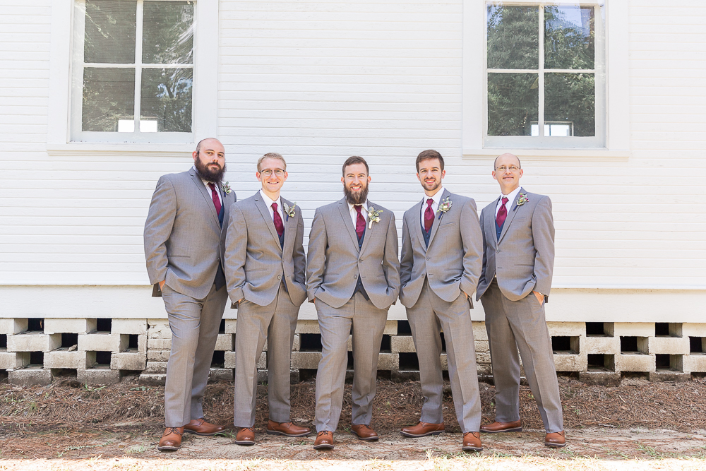 Annie Elise Photography | White Chapel Wedding | Groom Portrait Outdoors | Groomsmen in Maroon Tie
