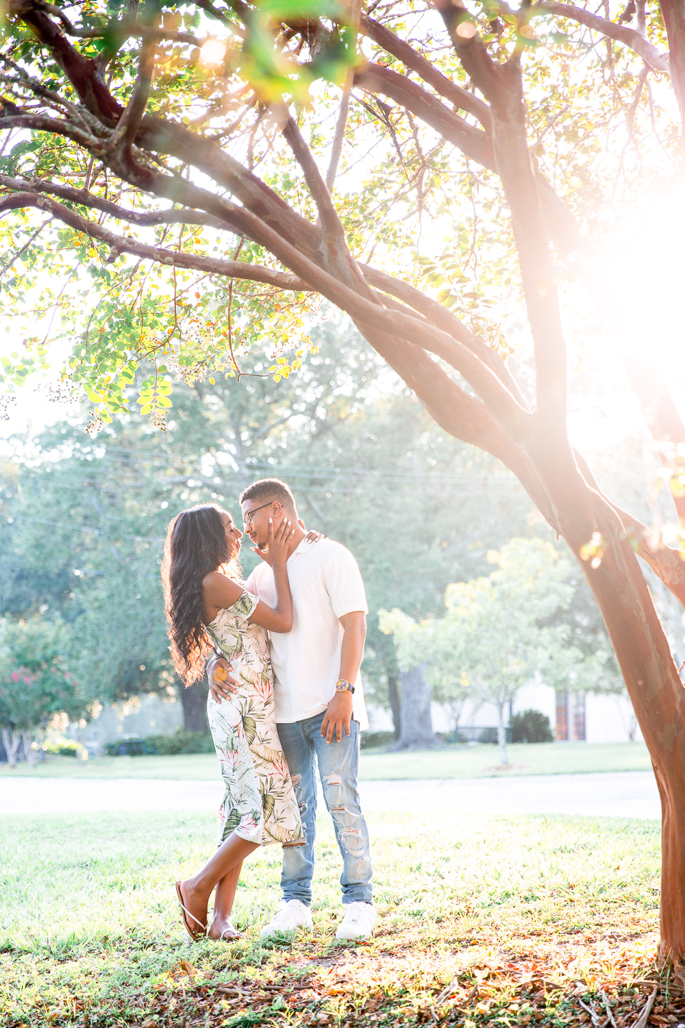 Couple kissing at engagement session | golden hour light